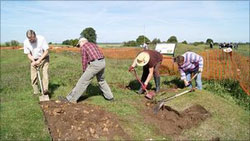 Volunteers begin to strip the turf from the abbey ruins at Bardney